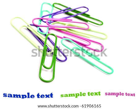 Colorful paper clips on a white background with space for text