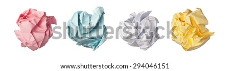 Colorful paper crumpled into balls isolated on white background