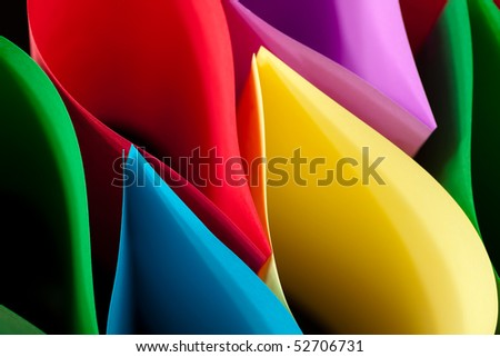 Colorful Paper Elliptical Shapes on a black background.