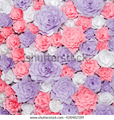 Colorful paper flowers background. Floral backdrop with handmade roses for wedding day or birthday - stock photo