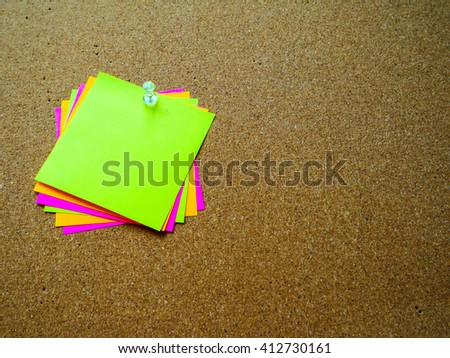 Colorful paper note on wood board with copy space - stock photo
