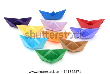 Colorful paper ships on white background - stock photo