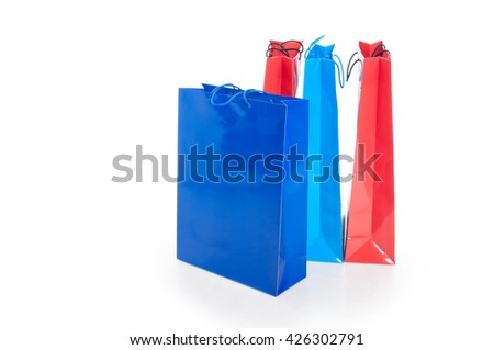 Colorful paper shopping bags including blue and red with advertising area isolated on white