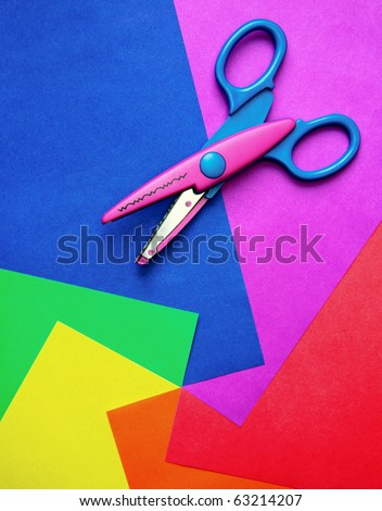 Colorful paper with child's scissors - stock photo