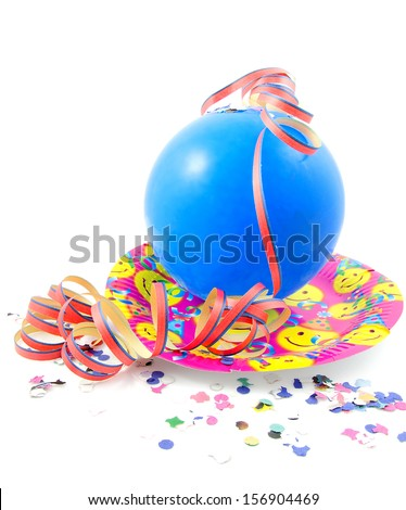 Colorful party accessory with blue balloon and streamers over white background