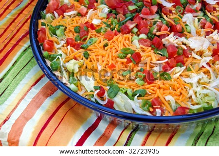 colorful party appetizer on striped tablecloth - stock photo