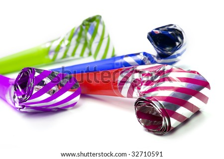 Colorful party blowers isolated on white background - stock photo