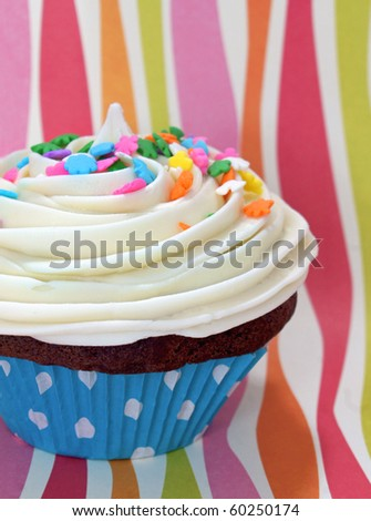 Colorful party cupcake - stock photo