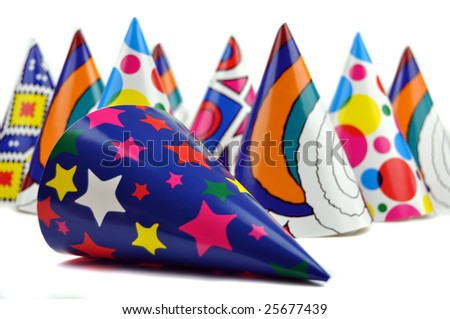 Colorful party hats on a white background