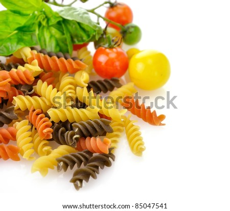 Colorful pasta on white with tomatoes and spices - stock photo