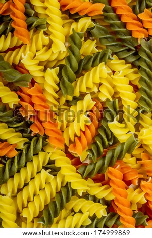 Colorful pasta texture backdrop. Raw state. Italian food - stock photo