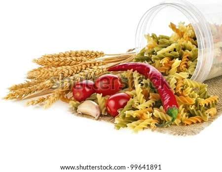 Colorful pasta with wheat, tomato, pepper, garlic on a white - stock photo