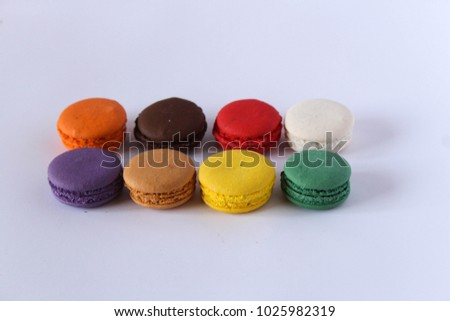 Colorful pastel beige brown vanilla coffee chocolate french macaroon biscuit on white background