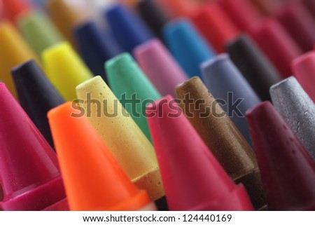 Colorful pastel(crayon) pencils tips for children and others used for kids drawing & coloring arranged attractively in rows and columns making a stunning display of colors - stock photo