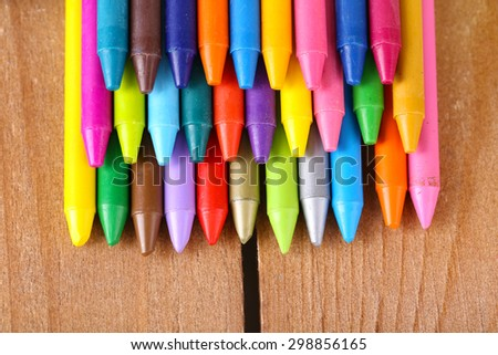 Colorful pastel crayons on wooden table, closeup - stock photo