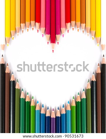 Colorful pastel pencil arrange in heart shape on white background - stock photo