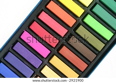 Colorful Pastels Arranged in a Rainbow Isolated on a White Background
