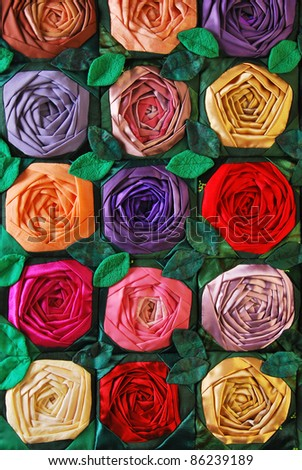 Colorful patchwork quilt with flowers. Handmade work - stock photo