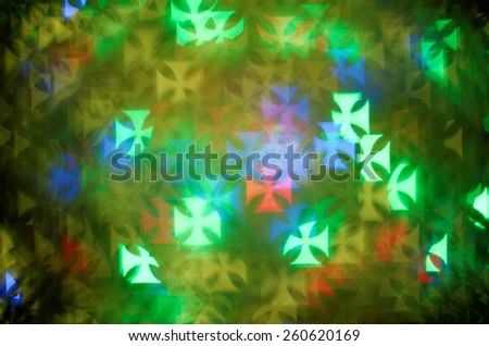 colorful pattee cross bokeh background - stock photo