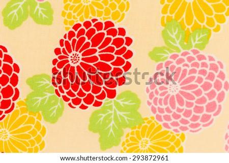 Colorful pattern chrysanthemum on cream fabric background,  Dendranthemum grandifflora - stock photo
