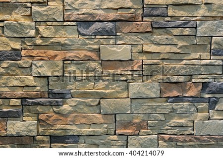 Colorful pattern of decorative brown grey slate stone wall surface, background, texture, pattern - stock photo