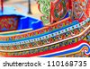 Colorful pattern of traditional fisherman boats These wooden boats were made and painted by boat makers in south of Thailand. - stock photo