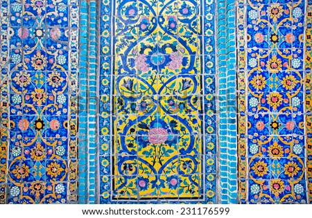 Colorful patterned wall with tiles of historical persian building in Iran - stock photo