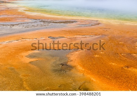 Colorful patterns in the algea and bacteria layers of the Grand Prismatic Spring, Yellowstone National Park - stock photo
