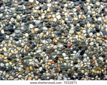 Colorful pebble stones texture for balinese pond decor - stock photo