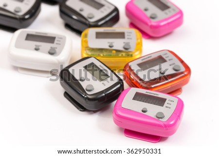 Colorful pedometers over white background.