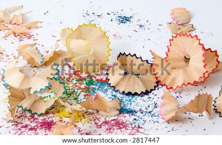 Colorful pencil shavings on white background