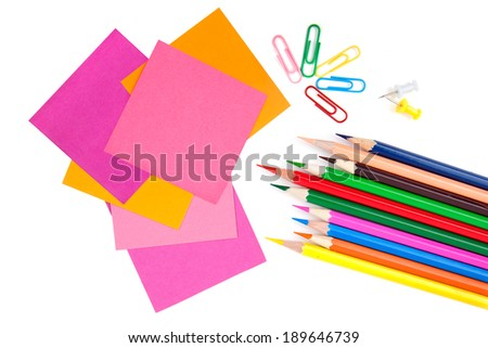 Colorful pencils and notes isolated over white with copyspace  - stock photo