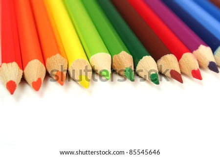 Colorful pencils close-up on white background. Macro with shallow dof. - stock photo