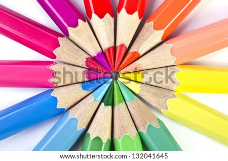 Colorful pencils closeup isolated over white