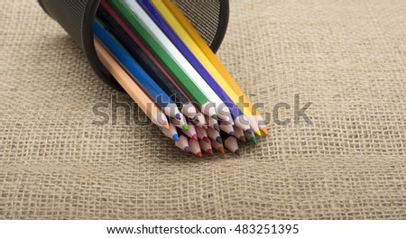 Colorful pencils coming out of holder close up