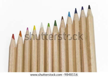 colorful pencils on white background in vertical position