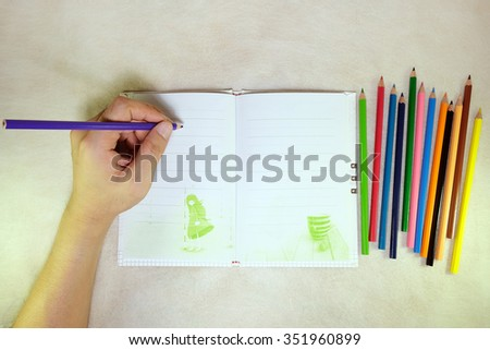 Colorful pencils with hand and Note.on the mulberry paper cream tone. - stock photo
