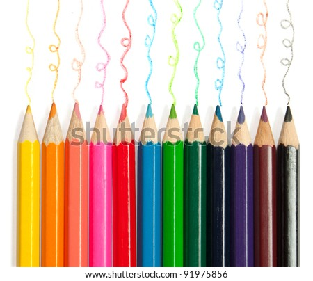 Colorful pencils with hand-drawn lines - stock photo
