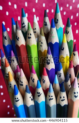 Colorful pencils with smiling faces.  - stock photo