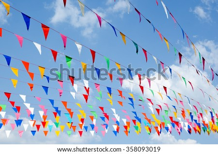 colorful pennants with sky - stock photo