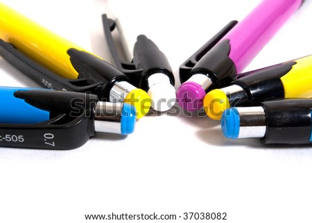 colorful pens in row isolated on white