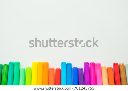 Colorful pens isolated on a white background.