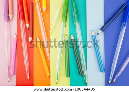Colorful pens placed in a portrait orientation on a colorful notes