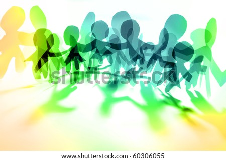 Colorful people holding hands together - stock photo