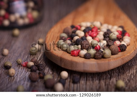 colorful pepper in wooden spoon