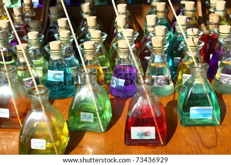 Colorful perfume bottles in local market - stock photo