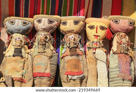 Colorful Peruvian dolls in the market - stock photo