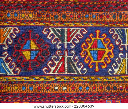 Colorful peruvian fabric style rug surface close up - stock photo
