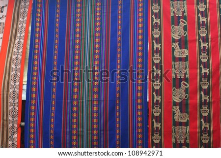 Colorful peruvian textiles at markets - stock photo