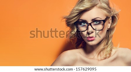 Colorful photo of a blonde woman wearing glasses - stock photo